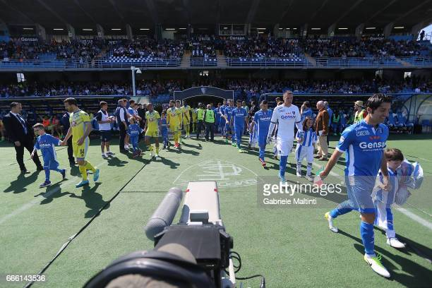 The teams walk out onto the pitch ahead of the Serie A match between Empoli FC and Pescara Calcio at Stadio Carlo Castellani on April 8 2017 in...
