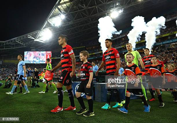 The teams walk out onto the pitch during the round one ALeague match between the Western Sydney Wanderers and Sydney FC at ANZ Stadium on October 8...