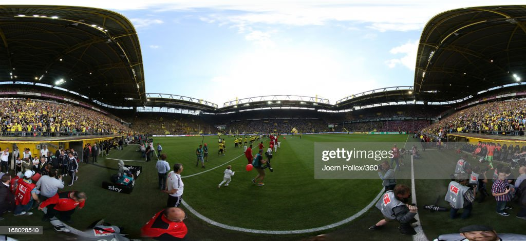 The teams walk out onto the pitch prior to the Bundesliga match between Borussia Dortmund and FC Bayern Muenchen at Signal Iduna Park on May 4, 2013 in Dortmund, Germany.