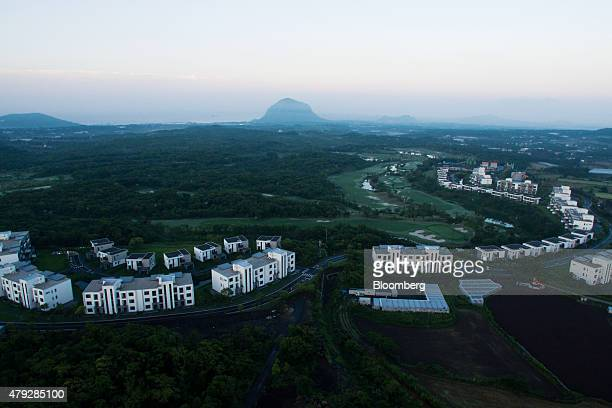 The Teddy Palace apartments developed by Jeju China Castle Ltd stand in this aerial photograph taken above Seogwipo in Jeju South Korea on Sunday...