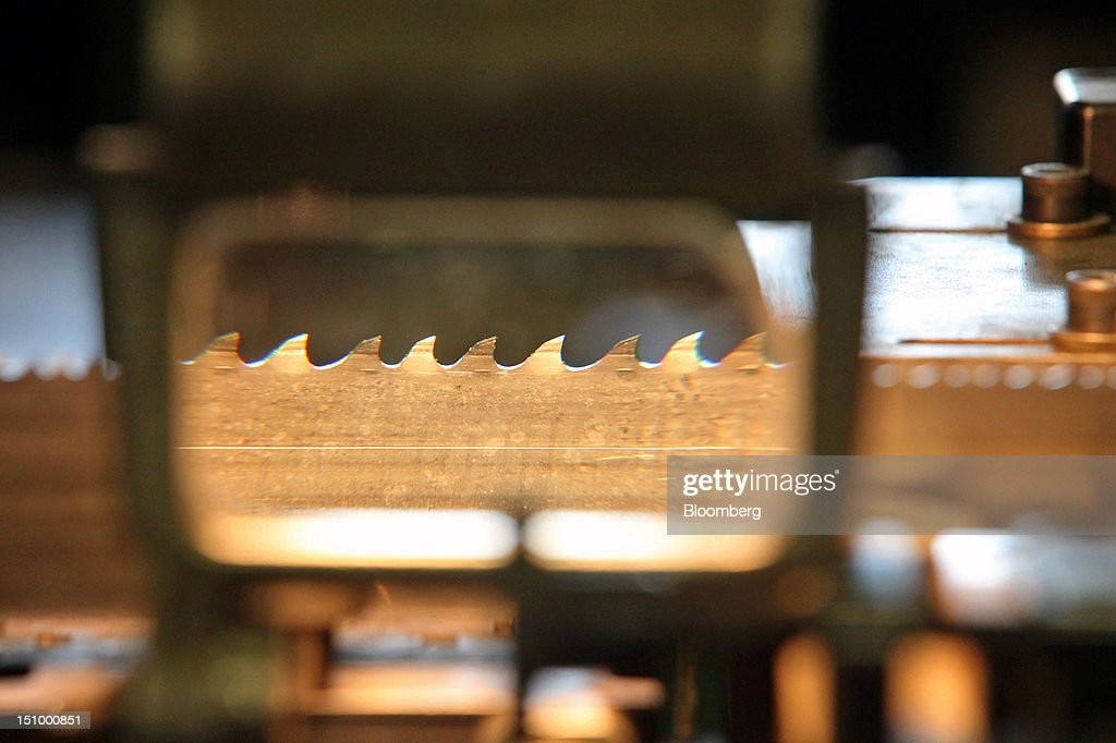 The teeth-setting process for manufacturing band saw blades is displayed through a magnifying glass at DoALL Company's Contour Saws Inc. facility in Des Plaines, Illinois, U.S., on Tuesday, Aug. 28, 2012. The U.S. Census Bureau is scheduled to release factory orders data on Aug. 31. Photographer: Tim Boyle/Bloomberg via Getty Images
