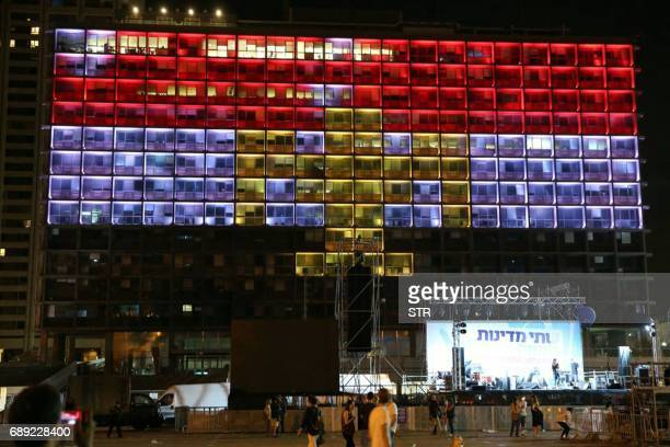 The Tel Aviv Municipality building is illuminated with the colours of the Egyptian flag as a sign of solidarity with the victims of the terror attack...