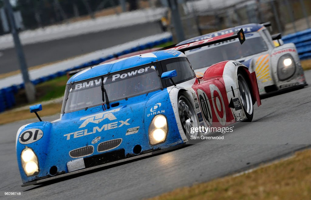 The #01 TELEMEX/Target BMW Riley driven by <a gi-track='captionPersonalityLinkClicked' href=/galleries/search?phrase=Scott+Pruett&family=editorial&specificpeople=541449 ng-click='$event.stopPropagation()'>Scott Pruett</a>, Memo Rojas, Justin Wilson, and <a gi-track='captionPersonalityLinkClicked' href=/galleries/search?phrase=Max+Papis&family=editorial&specificpeople=226808 ng-click='$event.stopPropagation()'>Max Papis</a> races during the Grand-Am Rolex 24 at Daytona held at Daytona International Speedway on January 31, 2010 in Daytona Beach, Florida.