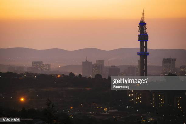 The Telkom Tower operated by Telkom SA SOC Ltd stands near residential apartment blocks at dusk in Pretoria South Africa on Tuesday July 25 2017...