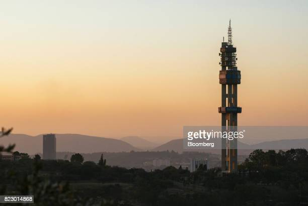 The Telkom Tower operated by Telkom SA SOC Ltd stands on the city skyline at dusk in Pretoria South Africa on Tuesday July 25 2017 South Africa is...