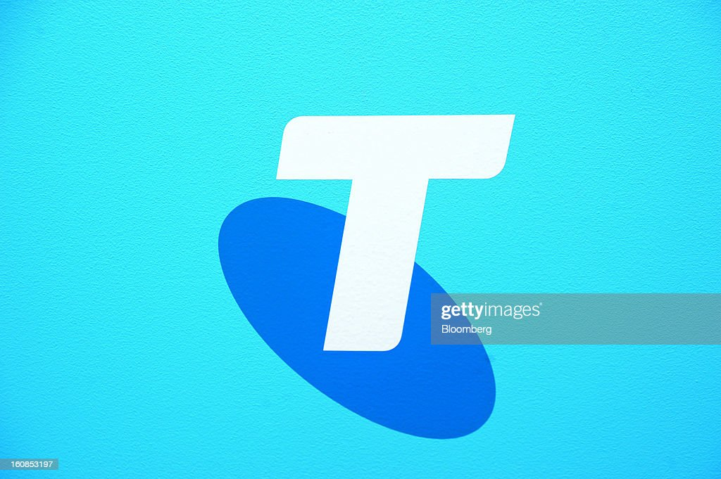 The Telstra Corp. logo is displayed at a news conference at the company's headquarters in Melbourne, Australia, on Thursday, Feb. 7, 2013. Telstra Corp., Australia's largest phone company, posted first-half profit that matched analyst estimates as it added 607,000 new mobile customers. Photographer: Carla Gottgens/Bloomberg via Getty Images