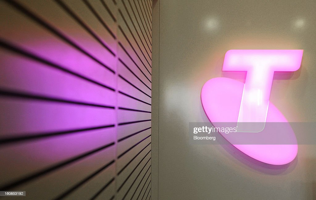The Telstra Corp. logo is displayed at the company's headquarters in Melbourne, Australia, on Thursday, Feb. 7, 2013. Telstra Corp., Australia's largest phone company, posted first-half profit that matched analyst estimates as it added 607,000 new mobile customers. Photographer: Carla Gottgens/Bloomberg via Getty Images