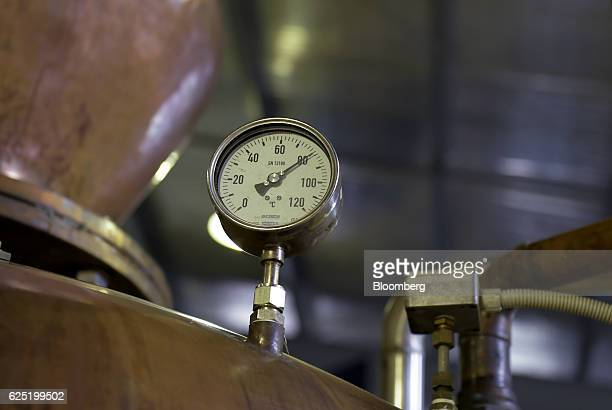 The temperature of distilled whisky is displayed on a thermometer gauge on a copper pot still at the Sullivans Cove whisky distillery in Hobart...