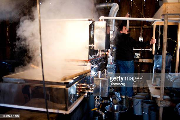 The temperature of the evaporator is checked in the sugar shack at Richards Maple Products in Chardon Ohio on Saturday March 9 2013 Grade A syrup...