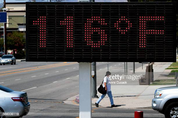 The temperature reads 116 degrees farhenheit as a pedestrian walks along Vanowen Street during a heat wave that is scorching the Southland in some...