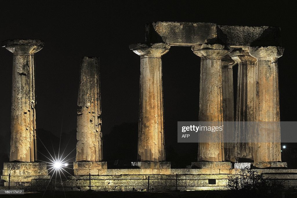 The Temple of Apollon in Ancient Corinth is pictured during the inauguaration of its lighting on January 26, 2013 a move aimed at attracting both local and international tourists . AFP PHOTO/ VALERIE GACHE