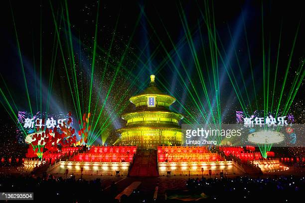 The Temple of Heaven is illuminated as Beijing celebrates the New Year's Eve at the Temple of Heaven Park on December 31 2011 in Beijing China The...
