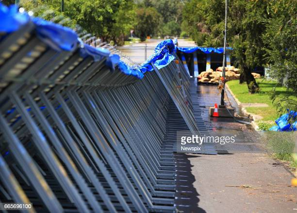 ROCKHAMPTON QLD The temporary levee keeping the rising floodwaters at bay at Berserker in Rockhampton Queensland after the Fitzroy River burst its...