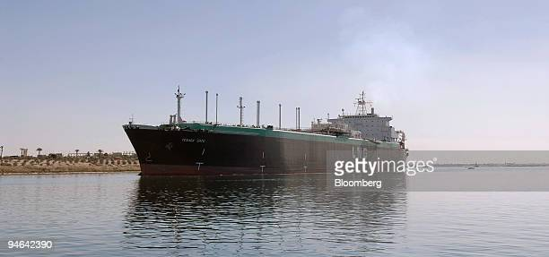 The Tenaga Satu a Liquefied Natural Gas tanker owned by MISC Berhad a Malaysian shipping company sails northbound on the Suez Canal in Ismailia Egypt...