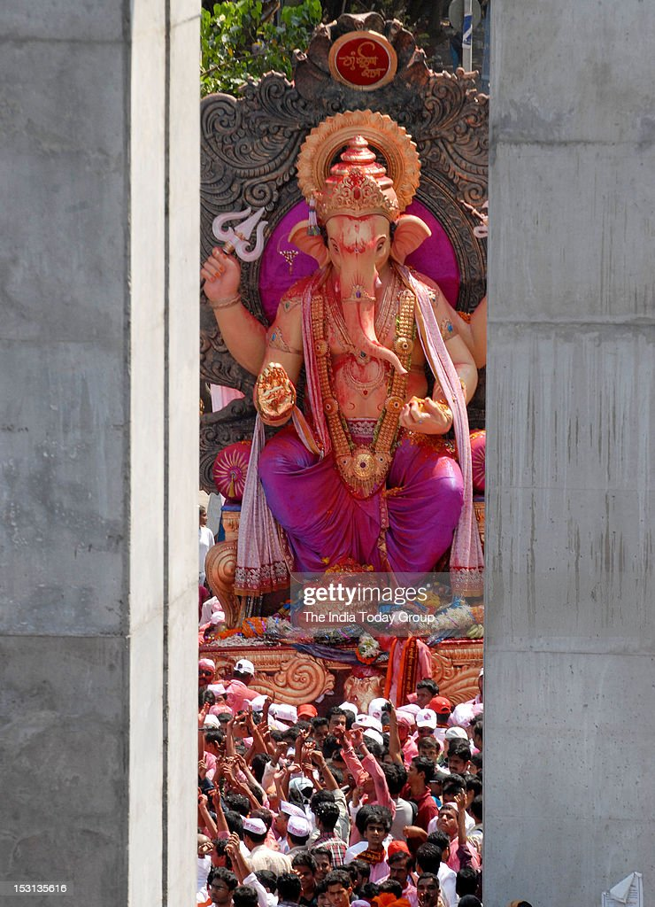 The ten-day Ganesh Utsav festivities in Mumbai culminated on Saturday, September 29, 2012 with the immersion of Ganesh idols. People in large numbers lined up the streets to witness the immersion of Ganesha idols.