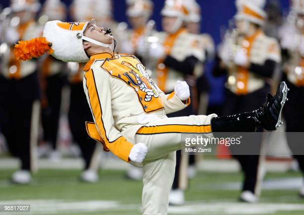 The Tennessee Volunteers drum major leads the band on the field before the ChickFilA Bowl against the Virginia Tech Hokies at the Georgia Dome on...