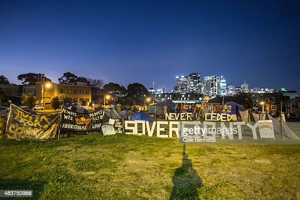 The tent embassy on 'The Block' in redfern back dropped by the city of Sydney at night on August 9 2015 in Sydney Australia The tent embassy was...
