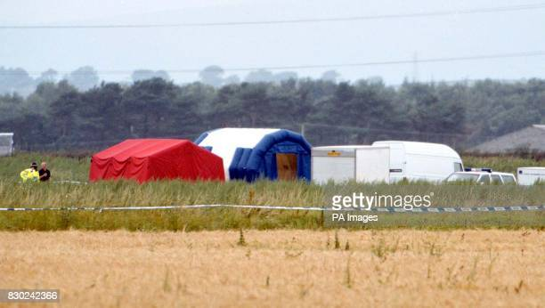The tented area used by the Air Accident investigators while looking at the crash site of the twin engine Cessna 404 which crashed killing eight...