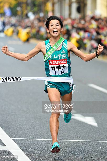 The tenth and final runner of Aoyama Gakuin University Toshinori Watanabe crosses the finishing tape to win during the 92nd Hakone Ekiden on January...