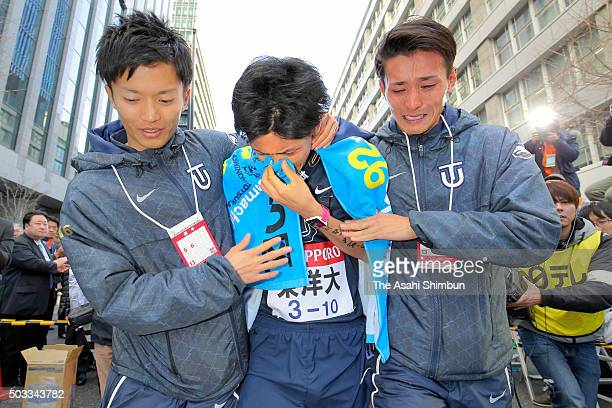 The tenth and final runner of Toyo University Kazuma Watanabe sheds tears after finishing second during the 92nd Hakone Ekiden on January 3 2016 in...