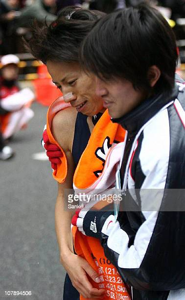 The Tenth and final runner of Toyo University Kenji Yamamoto shows his dejection as Toyo University finish the 87th Hakone Ekiden as runnersup on...