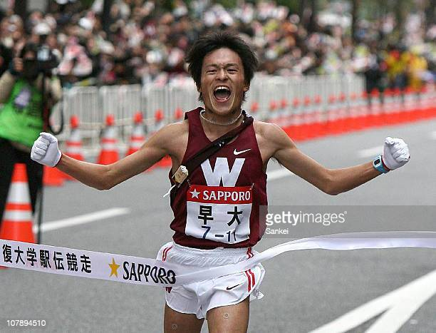 The Tenth and final runner of Waseda University Kenji Nakashima crosses the finish line to win the 87th Hakone Ekiden on January 3 2011 in Tokyo Japan