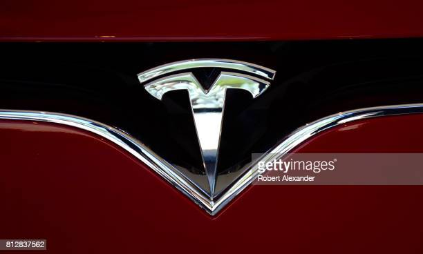 The Tesla brand logo embellishes the nose of a Tesla electric sedan in Vail Colorado
