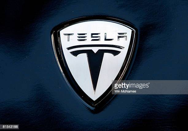 The Tesla electric car logo is shown during a display of alternative energy vehicles on Capitol Hill June 12 2008 in Washington DC As part of the...