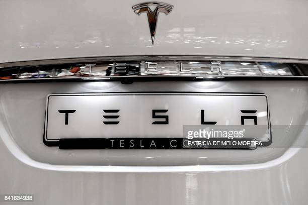 The Tesla logo is pictured on a car at the electric carmaker Tesla showroom of El Corte Ingles store in Lisbon on September 1 2017 / AFP PHOTO /...