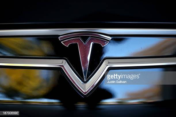 The Tesla logo is shown on the front of a new Tesla Model S car at a Tesla showroom on November 5 2013 in Palo Alto California Tesla will report...