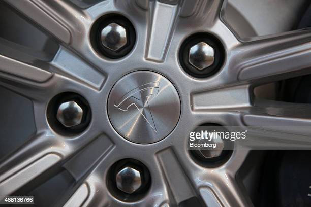 The Tesla logo sits on a wheel hub inside the Tesla Motors Inc store in Munich Germany on Monday March 30 2015 Chief Executive Officer Elon Musk...