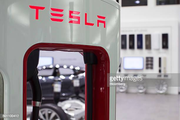 The Tesla logo sits on an electric charging point inside the showroom of a Tesla Inc dealership in Amsterdam Netherlands on Friday Dec 11 2015 After...
