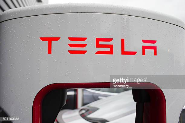 The Tesla logo sits on an electric charging point on the forecourt of a Tesla Inc dealership in Amsterdam Netherlands on Friday Dec 11 2015 After...