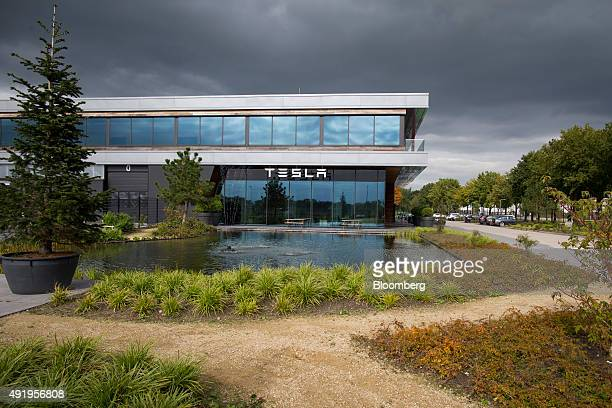 The Tesla logo sits on the exterior of the Tesla Motors Inc factory in Tilburg Netherlands on Thursday Oct 8 2015 Tesla said it delivered 11580...