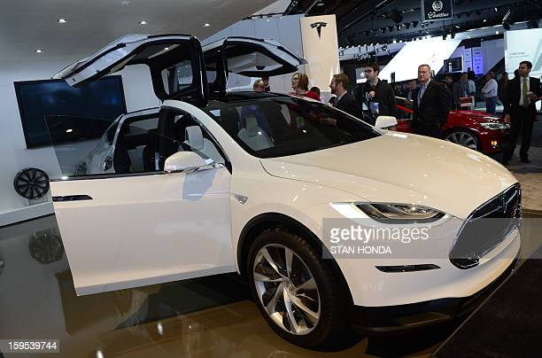The Tesla Model X is introduced at the 2013 North American International Auto Show in Detroit Michigan January 15 2013 AFP PHOTO/STAN HONDA