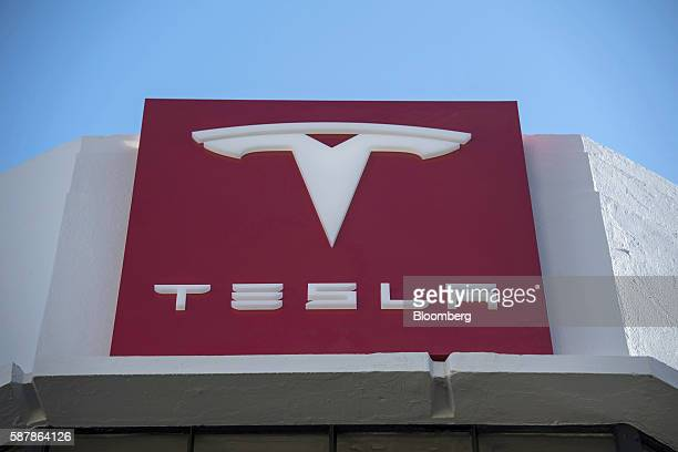 The Tesla Motors Inc logo is displayed on the facade of the company's new showroom in San Francisco California US on Tuesday Aug 9 2016 Tesla marked...