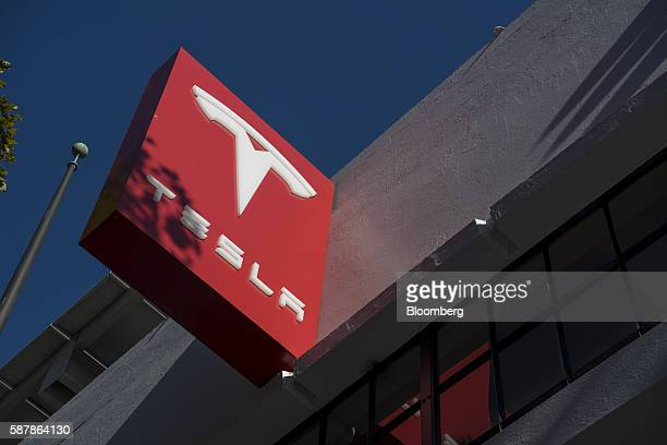 The Tesla Motors Inc logo is displayed outside the company's new showroom in San Francisco California US on Tuesday Aug 9 2016 Tesla marked the...