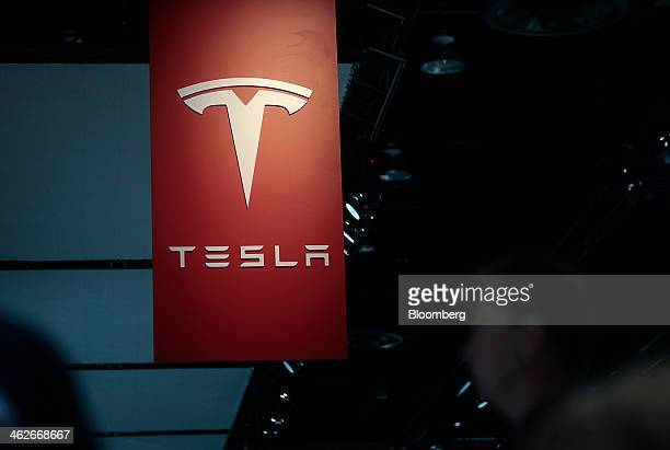 The Tesla Motors Inc logo is seen at the company's booth during the 2014 North American International Auto Show in Detroit Michigan US on Tuesday Jan...