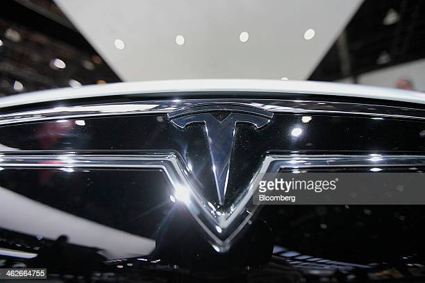 The Tesla Motors Inc logo is seen on a Model S sedan at the company's booth during the 2014 North American International Auto Show in Detroit...