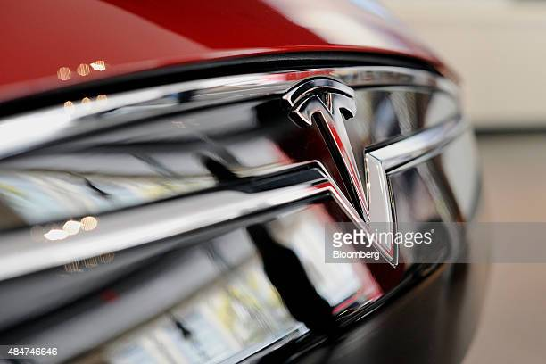 The Tesla Motors Inc logo is seen on the grill of a Model S P85D electric vehicle at the company's retail store in San Jose California US on Thursday...