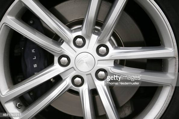 The Tesla Motors Inc logo is seen on the hubcap of a Model Tesla S 85 sedan electric car at a supercharging station on the A6 highway on January 21...