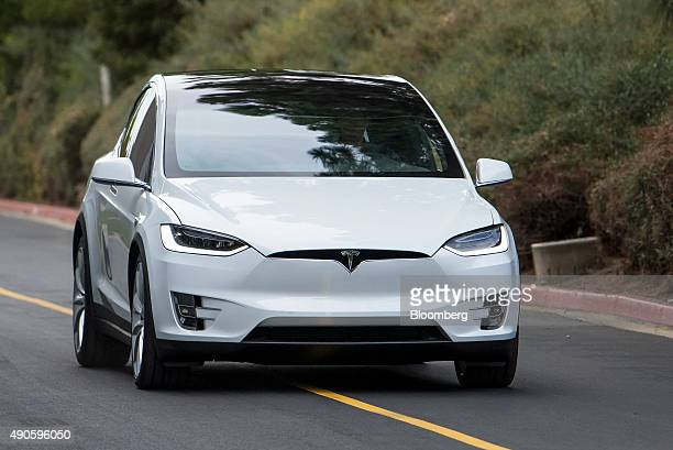 The Tesla Motors Inc Model X sport utility vehicle is driven during an event in Fremont California US on Tuesday Sept 29 2015 Elon Musk handed over...