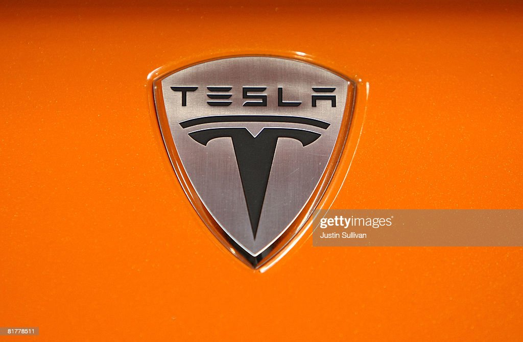 The Tesla Motors is seen on the hood of a Tesla Roadster after a news conference with California governor Arnold Schwarzenegger June 30, 2008 at Tesla Motors in San Carlos, California. Governor Schwarzenegger announced that electric car company Tesla Motors will build a new manufacturing facility in California to manufacture its all-electric Tesla Roadster. The $109,000 2009 Tesla Roadster zero emissions vehicle is capable of traveling nearly 250 miles on a single charge and is capable of going 0-60 miles per hour in 3.9 seconds.