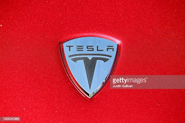 The Tesla Motors logo is seen on the hood of a car at Tesla Motors headquarters May 20 2010 in Palo Alto California Electric car maker Tesla Motors...