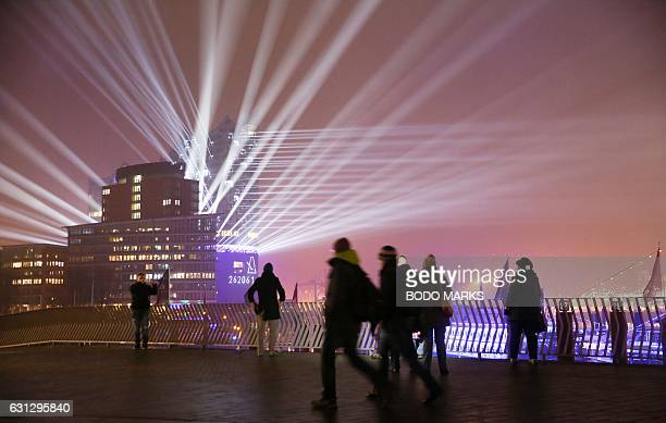 The test run of a light show illuminates the building of the Elbphilharmonie three days before the official inauguration of the new concert hall in...