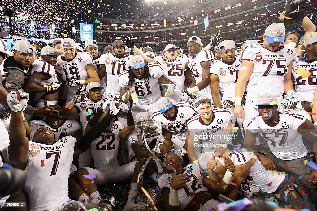 The Texas A&M Aggies celebrates a 41-13 win against the Oklahoma Sooners during the Cotton Bowl at Cowboys Stadium on January 4, 2013 in Arlington, Texas.