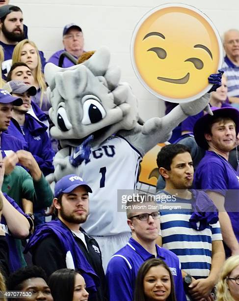 The Texas Christian University mascot holds up an emoji at the Horned Frogs' game against Southeastern Louisiana at Schollmaier Arena in Fort Worth...