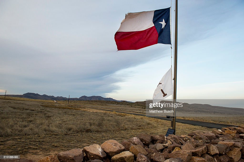 The Texas flag flies at half mast on Sunday at the Cibolo Creek Ranch, the day after the death of Supreme Court Justice Antonin Scalia, February 14, 2016 in Shafter, Texas.