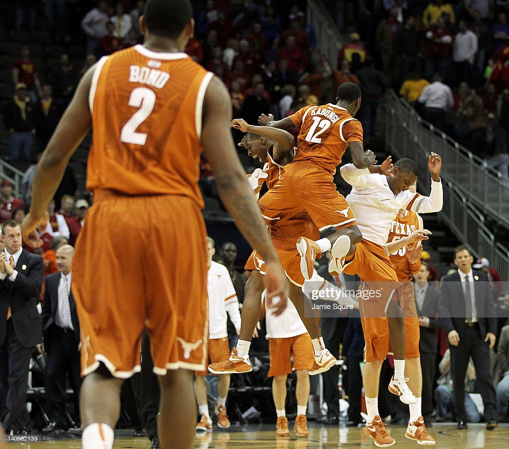 The Texas Longhorns celebrate after defeating the Iowa State Cyclones to win the NCAA Big 12 basketball tournament quarterfinal game on March 8, 2012 at Sprint Center in Kansas City, Missouri.
