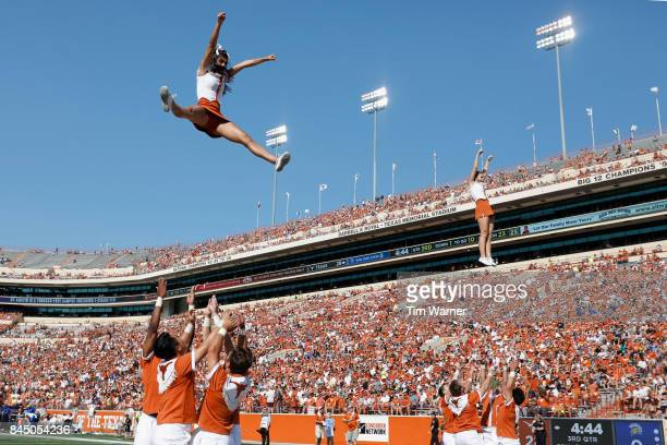 The Texas Longhorns cheerleaders perform in the third quarter against the San Jose State Spartans at Darrell K RoyalTexas Memorial Stadium on...